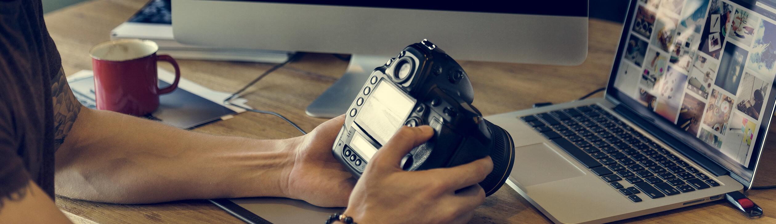Professional photographer checking recent photos